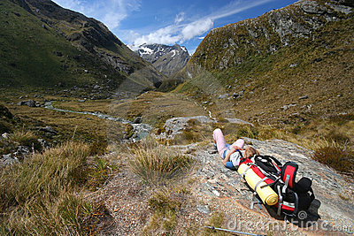 Hiker Resting In The Mountains