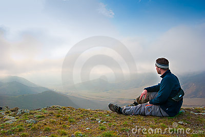 Hiker sits on a peak