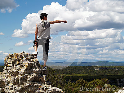 Hiker sitting near edge