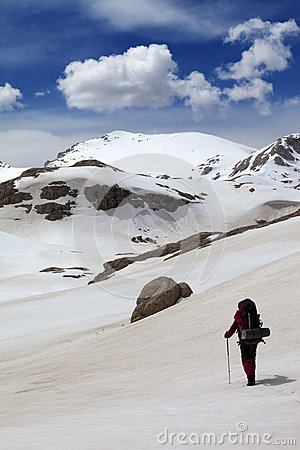 Hiker in snow mountains