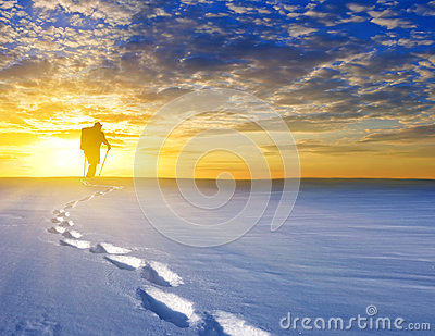 Hiker among a snowbound plain