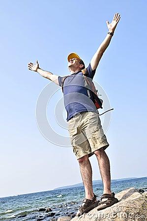 Hiker standing on a rock