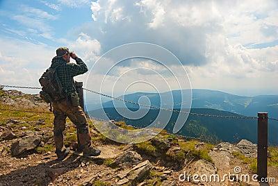 Hiker stands on a peak