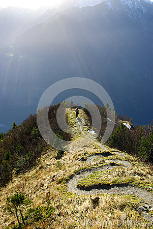 Hiker in Swiss Alps mountains