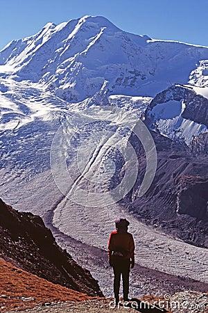 Hiker viewing glacier