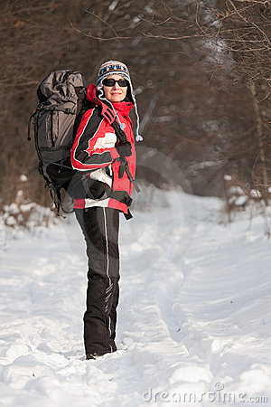 Hiker in winter forest