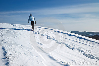 Hiker on the winter snow field