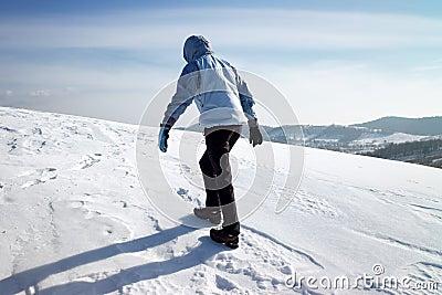 Hiker on the winter snow field