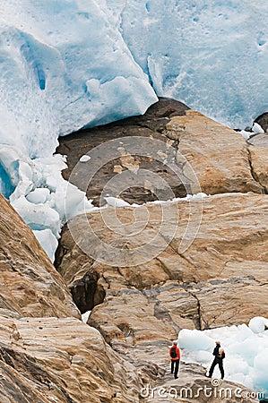 Hikers by glacier
