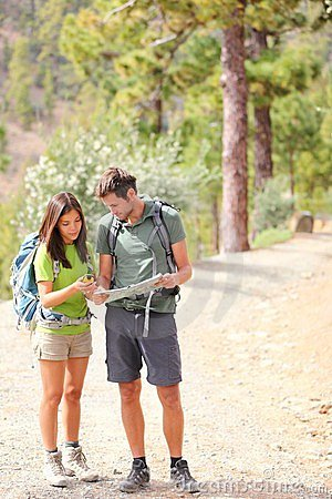 Hikers - hiking couple looking at map