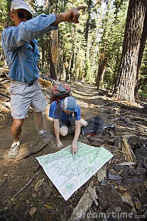 Hikers reading map.