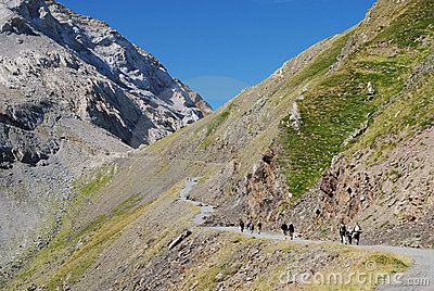 Hikers on the road along mountain Col de Tentes.