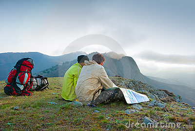 Hikers sit on the peak