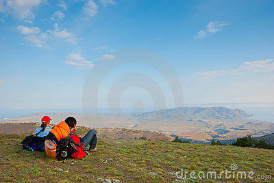 Hikers sit on the slope