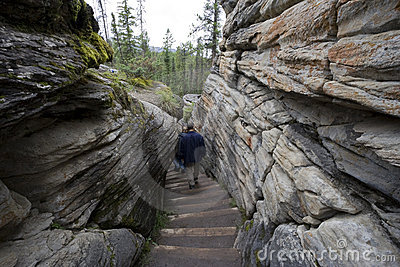 Hikers walking downstairs in the dry riverbed of a