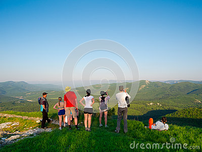 Hikers watch the terrain