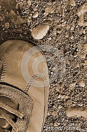 Hiking boot shoe hard arid dried soil