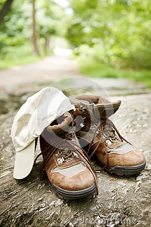 Hiking boots and hat in the woods