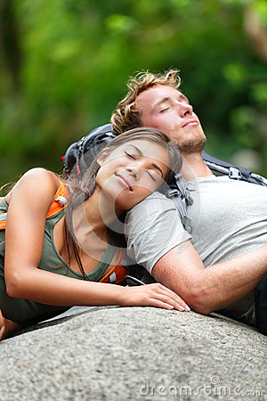 Hiking couple lovers relaxing sleeping in nature