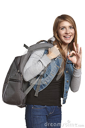 Excited girl with backpack howing OK gesture