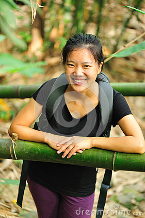 Hiking girl in bamboo forest