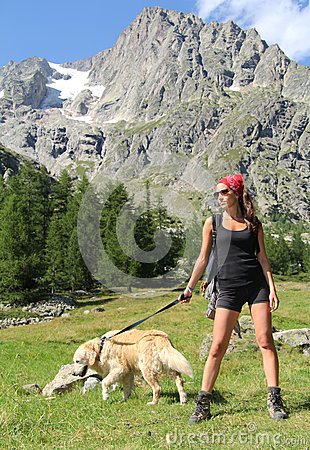 Hiking girl posing with her dog