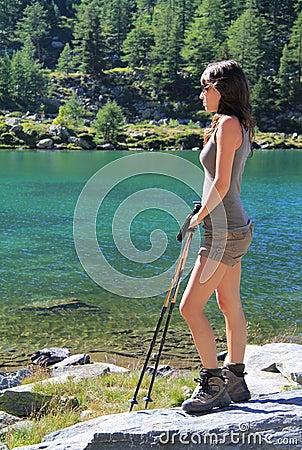 Hiking girl rests at Arpy lake