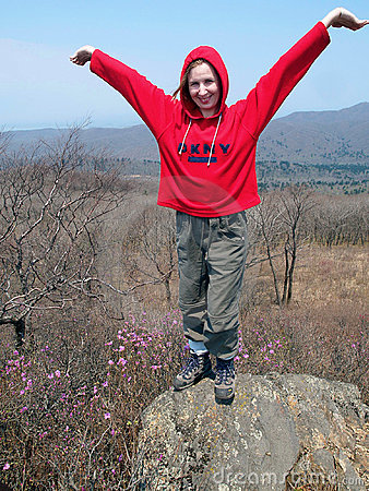 Hiking girl on the rock