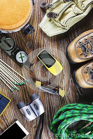 Free Hiking Or Travel Equipment With Boots, Compass, Binoculars, Matches On Wooden Background. Active Lifestyle Concept Stock Photos - 117296243