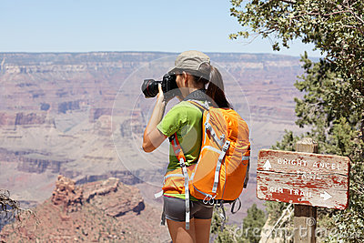 Hiking photographer taking pictures, Grand Canyon