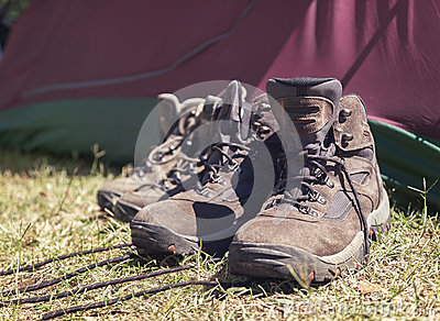Hiking shoes in front of tent