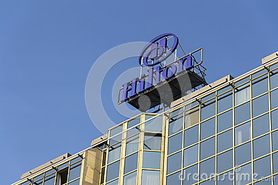 hilton hotels and resorts logo on the building of hilton