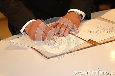Him signing it (Wedding ceremony)