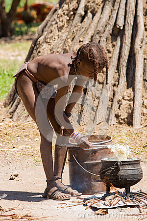 Himba Boy cooks for Lunch Editorial Photography