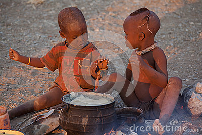Himba children eating Editorial Stock Image