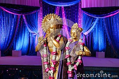 Hindu Deities in front of mandap at Indian wedding