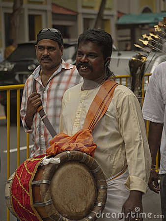 Hindu Devotee carrying a Drum Editorial Stock Image