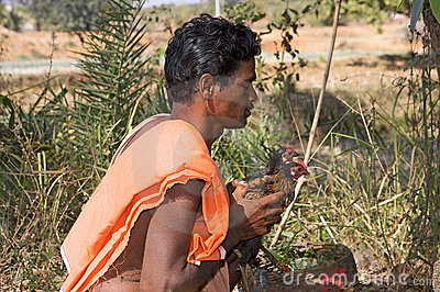 Hindu man and animal sacrifice Editorial Stock Photo