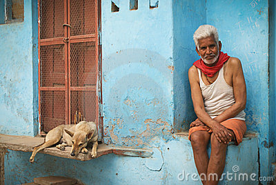 Hindu man and dog Editorial Photo