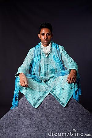 Hindu man sitting in lotus position