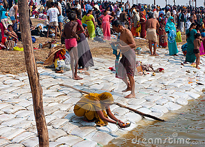 Hindu people praying and bathing Editorial Stock Image
