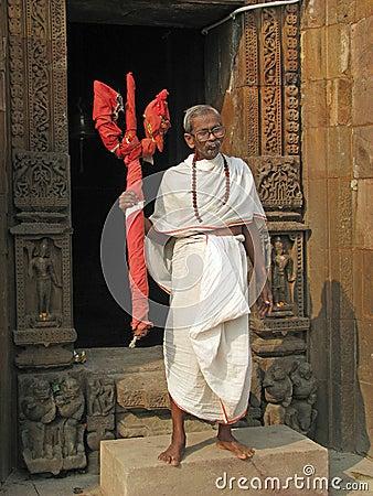 Hindu priest with Krishna simbol Editorial Image