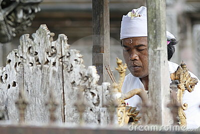 Hindu priest prays in Balinese Tirta Empul Temple Editorial Stock Photo