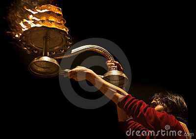 Hindu priest during religious Ganga Aarti ceremony Editorial Image