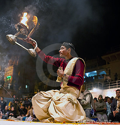 Hindu priest during religious Ganga Aarti ceremony Editorial Stock Image