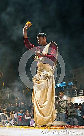 Hindu priest during religious Ganga Aarti ceremony Editorial Stock Image