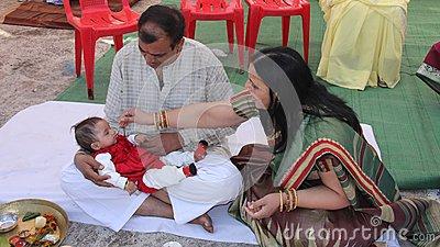 Hindu tradition for baby s first solid food by her Editorial Stock Image