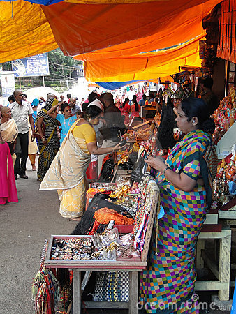 Hindu women browse the market Editorial Stock Image