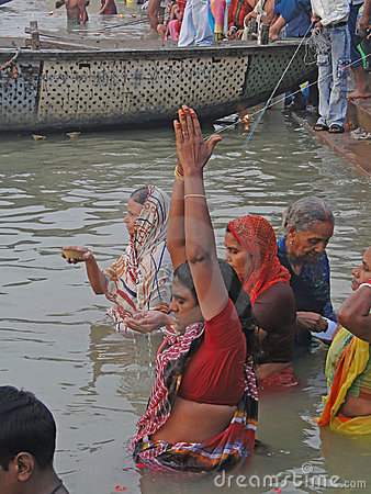 Hindus perform ritual puja at dawn in the Ganges Editorial Stock Image