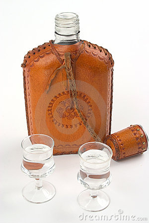 Hip flask and two glasses